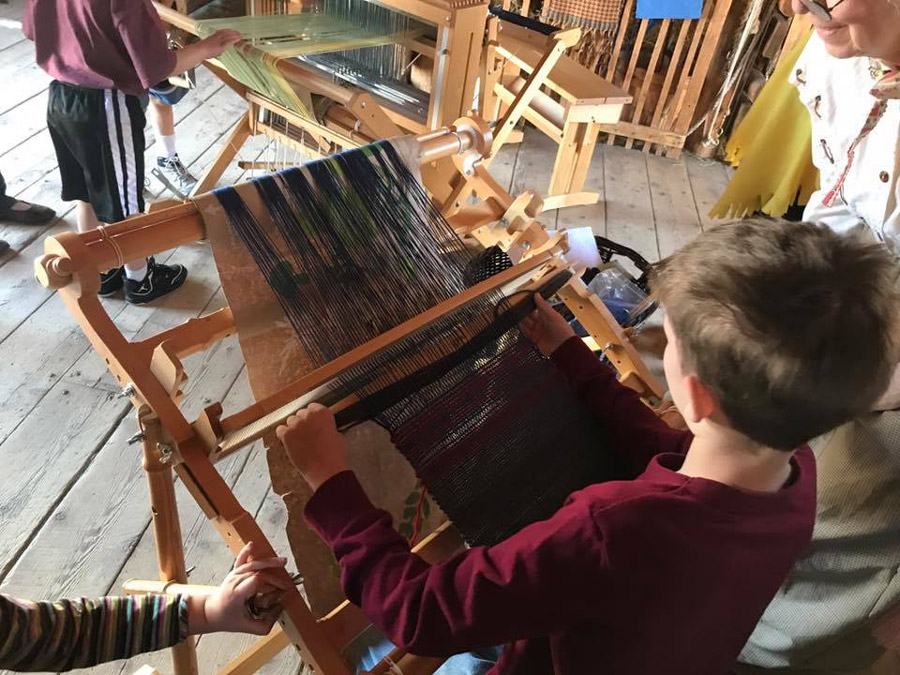 child with loom