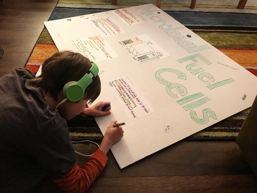 child working on poster